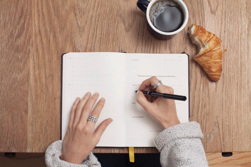 copywriting notebook croissant coffee