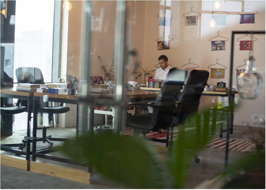 entrepreneur Faisal Sheraiff working behind a desk at his company modestudio