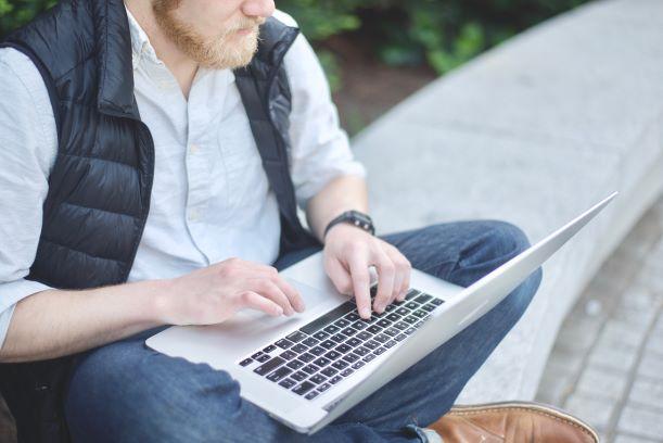 freelance person sitting laptop