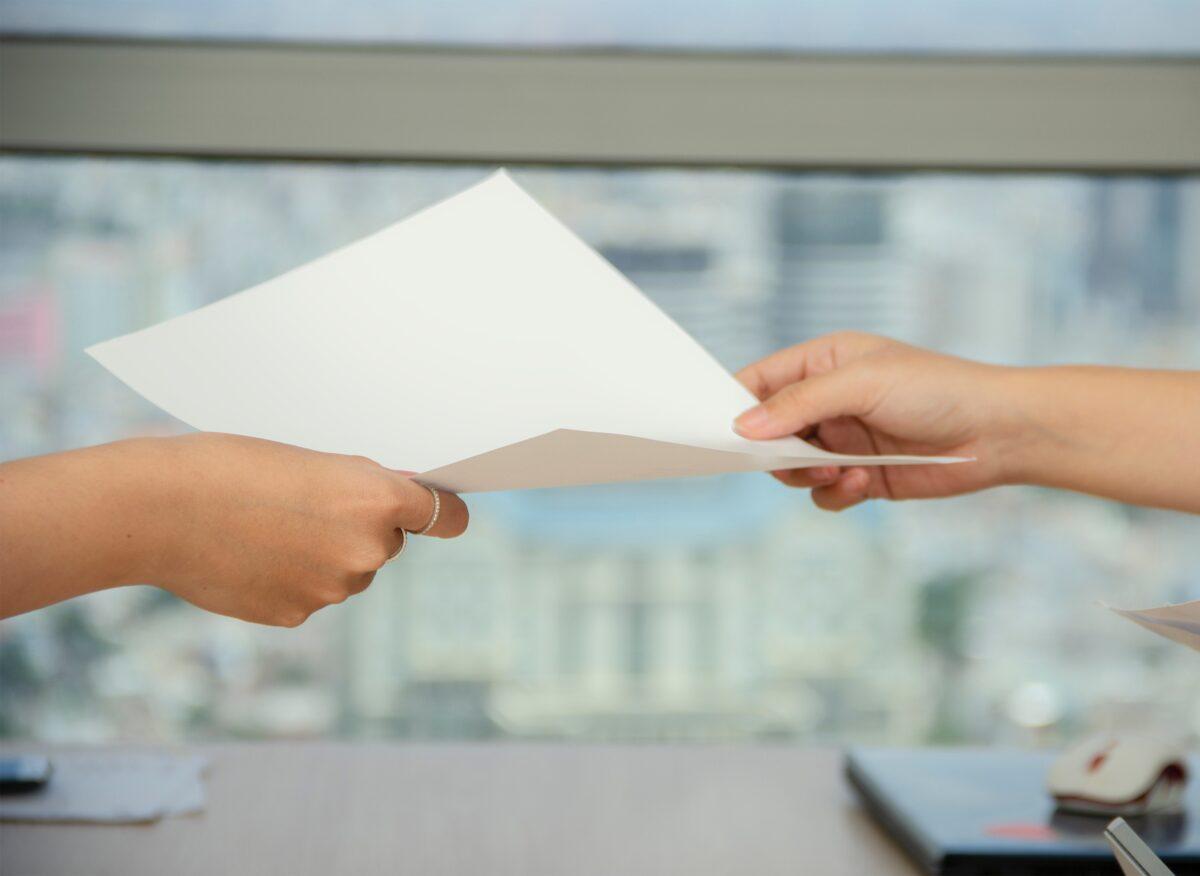 hands holding paper-summer sales