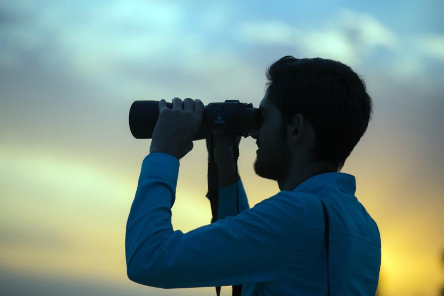 prepare for ramadan man with binoculars